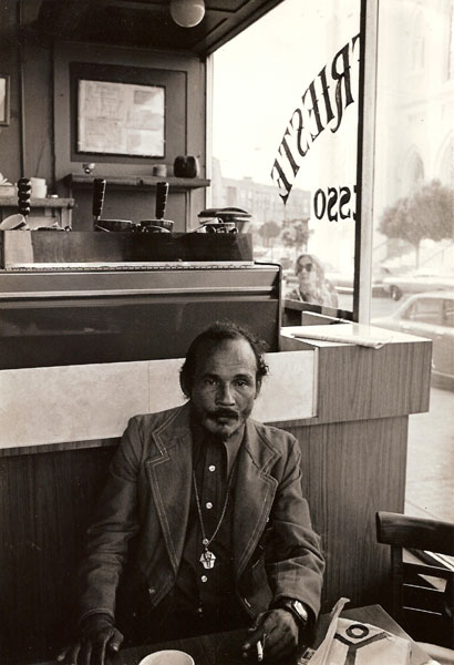 Bob Kaufman photographed by A.D. Winans at Cafe Trieste in North Beach, 1976. © A.D. Winans 1976.