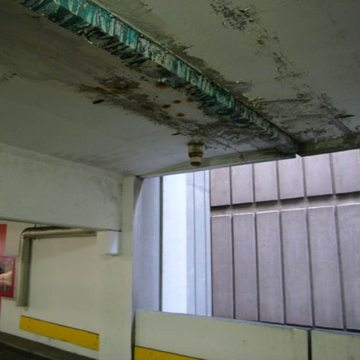 The photo illustrates vividly why expansion joints should be watertight at their top surface. And why gutters can lead to the need for seriously costly repairs. They underscore how gutters conceal leaks, resulting in structural damage that is dangerous and far more costly than the price of an expansion joint that works.