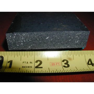 Conservatively Loaded: A sample of lightly loaded resin shows a good balance of aggregates and resin. The result is sufficient compressive strength to resist plow impact, and withstand traffic rigors, while not sacrificing flexibility.