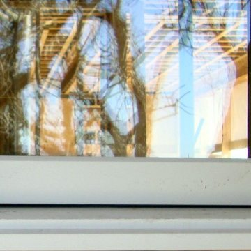 Colorseal-on-a-Reel between wood window mullions and air barrier wrapped opening.