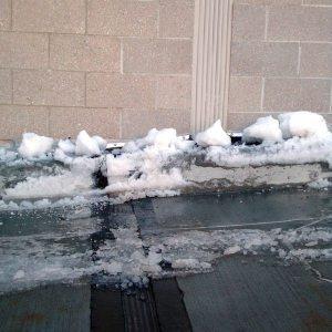 Continuity of seal through curb, sidewalk and between dissimilar materials at wall