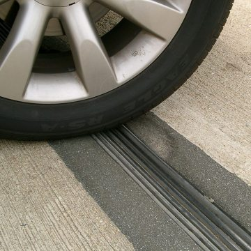 Inspection in June, 2004 of 8-year old THERMAFLEX nosing material at Ronald Reagan International Airport, Middle/North parking garage, shows localized shaving of nosing material to the right of the leading edge of the tire. Caused by errrant snow-plowing the impact scarring is superficial and repairable and the joint remains watertight.