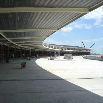 Migutan follows the curve on the departures roadway at the new Jet Blue terminal.