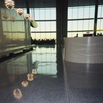 Airport floor expansion joint MIGUTRANS 75/… integrates unobtrusively with terrazzo flooring in Tampa International Airport.