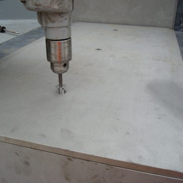 Attaching vertical riser cover plates. A factory-installed custom extrusion makes the transition between the tread and riser plates
