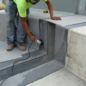 expansion joints in stadium adjusted for cover plates EMSEAL
