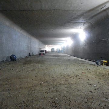 The tunnel is 620 Meters long (2,033 FT). The roof was poured in 50 sections.