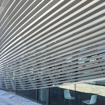 Window wall expansion joints sealed with Seismic Colorseal obscured by Swooping louvers