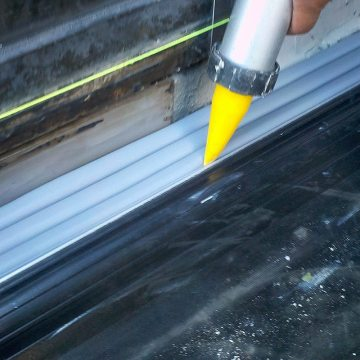 Plaza deck expansion joint sealing: DSM-FP in plaza to wall expansion joint injecting sealant band 2 Houston Center EMSEAL