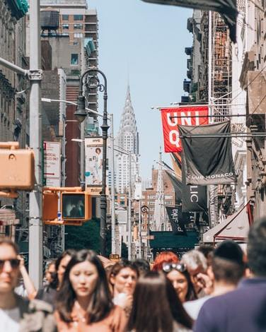 many people walking down the street in Soho, Manhattan.