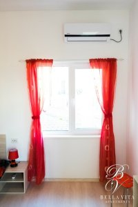Apartment for Rent Short Term in Blagoevgrad Bulgaria in Red and White with Air Conditioner