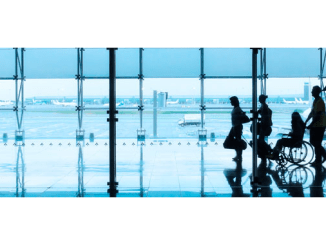 Silhouette of people walking in the airport