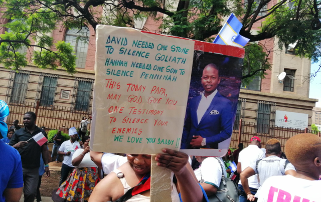 One of pastor Shepherd Bushiri's congregants outside court with a placard.