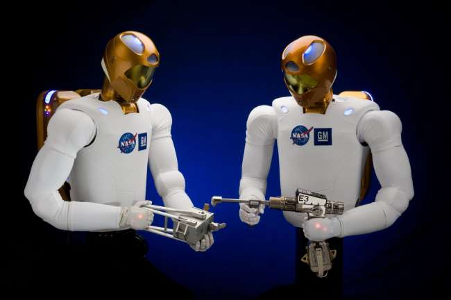 Space Robots: A picture of Robonaut 2 holding different tools