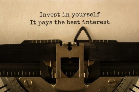 """a photo of a typewriter with the words """"Invest In Yourself It Pays The Best Interest"""" typed on a sheet of paper."""