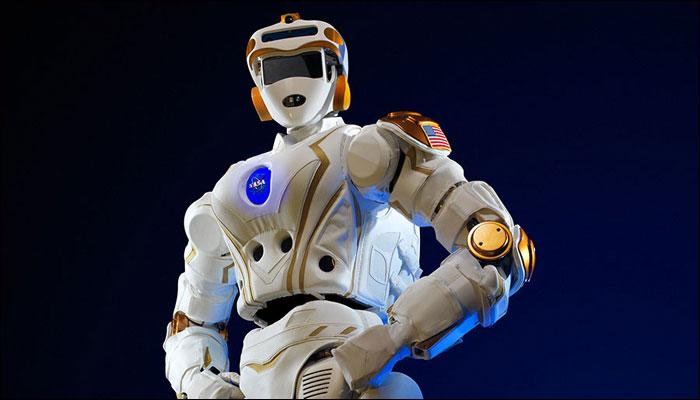 Space Robots: A picture of robonaut 5 with hands on hips.