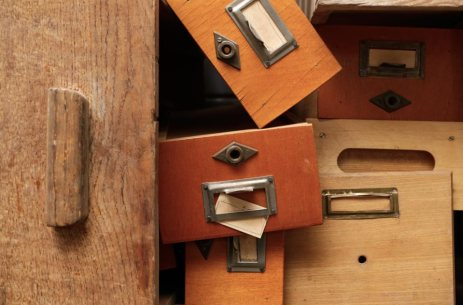 an image of disorganized wooden drawers.