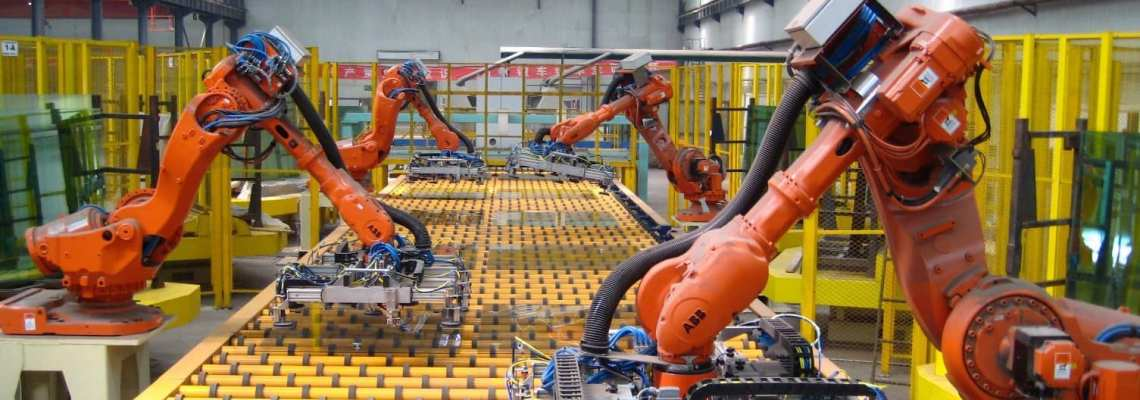 an image of fixed (hard) automation in manufacturing on the manufacturing factory floor