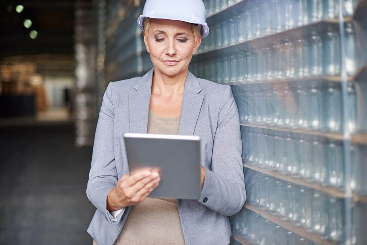 an image of a purchasing manager in a warehouse as part of ERP Supply Chain Management solutions