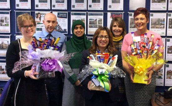 Staff from the organisations with chocolate bouquets