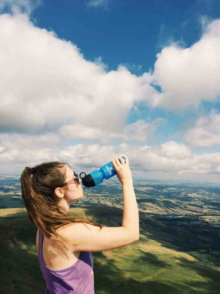 Every travel needs to invest in a travel filter water bottle. Here is your guide to travel filter water bottles, why travelers need one, and the best brand that filters out 99.9% of contaminants! #travel #travelwaterbottle #berkey #berkeyfilters #travelgear #travelfilterwaterbottle
