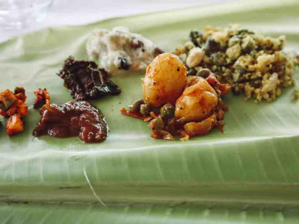 Examples of gluten free india dishes traditional to the south, served on a banana leaf.