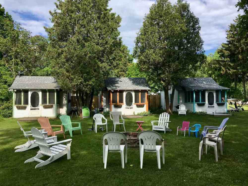 cottages with circled of adirondack chairs in Michigan