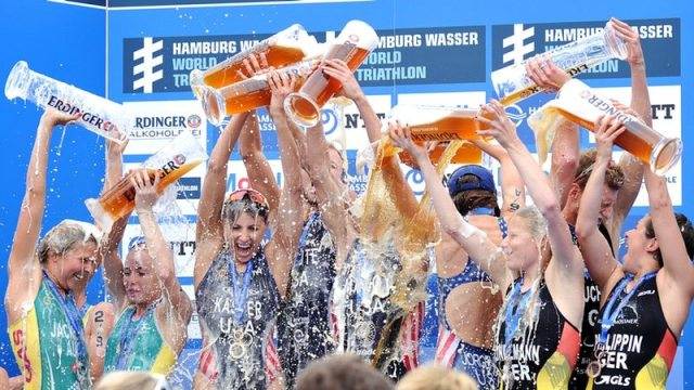 Tri Mixed Relay athletes on the podium in Hamburg - photo credit International Triathlon Union - Janos Schmid