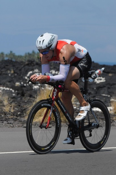 Coach Patrick riding a 5:01 in Kona.