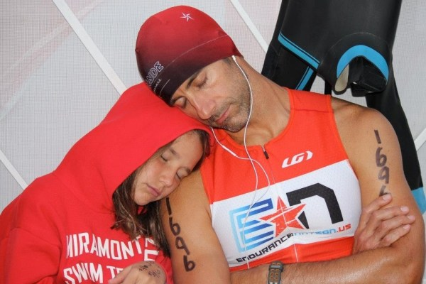 Joe Manning rests up with his little one before Lake Placid 2013