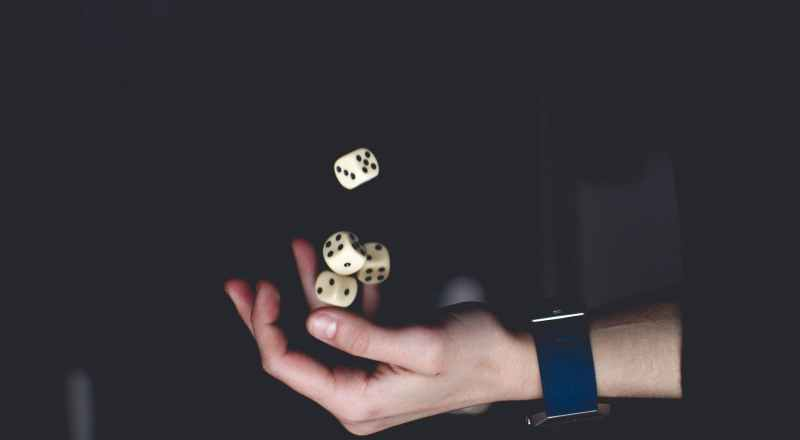 person about to catch four dices