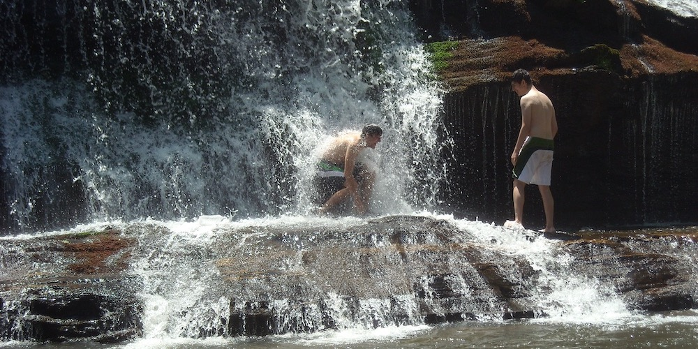Keeping Cool At A Waterfall In A Hot Summer