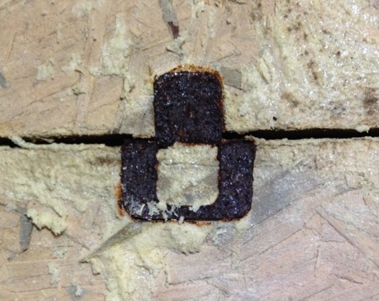 This rusty OSB clip shows the effects of moisture at the roof deck