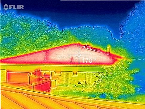 An infrared image of a hot, dark roof