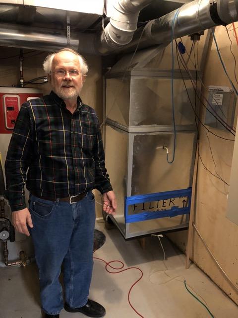 Gary Nelson standing next to his 18k Fujitsu ducted mini-split heat pump