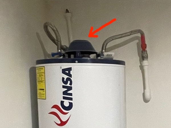 Natural draft gas water heater with no flue for exhaust gases