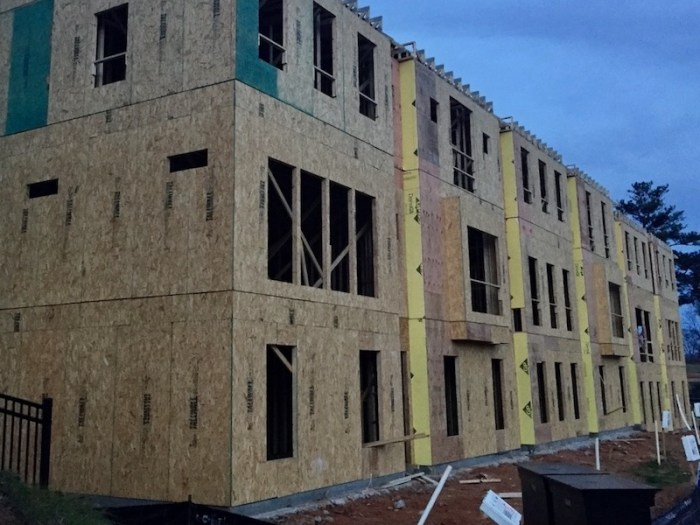 Traditional multifamily housing sheathed with OSB, plywood, and gypsum board