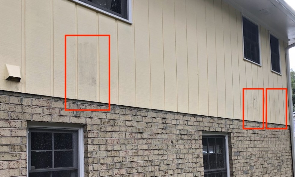 This house has uninsulated ducts in exterior walls. The discolored siding shows where they are.