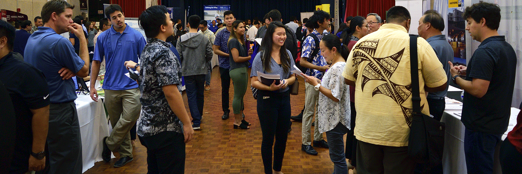 Wide Shot Of A Crowd Of Students And Recruiters Interacting.