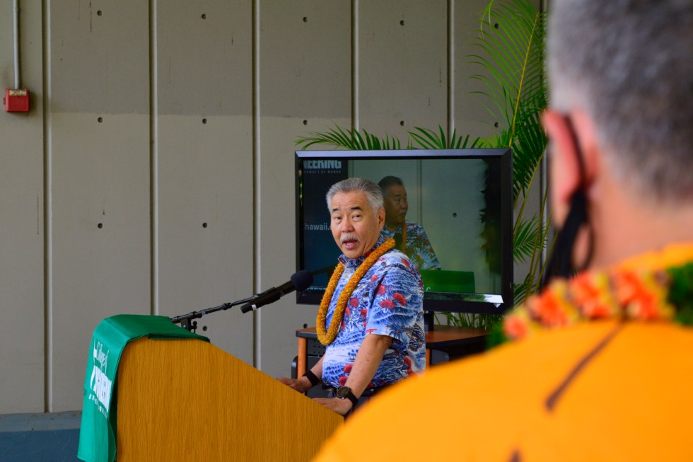 Dean Morioka Looks On While Governor Ige Delivers His Speech.