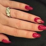 Perrie Edwards' 2.5 Carat Three-Stone Round Diamond Ring
