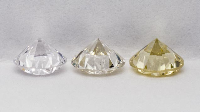 "Suite of three diamond master stones; ""E"", ""K-L"" and ""Z"" in grading position: table down, pavilion view."