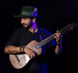 Sinhué Padilla playing the jarana for En Garde Arts