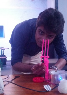 Anish Ralhan (UCL Electronic & Electrical Engineering) works on a 3D printed robot arm to enable a mobile phone to track satellites