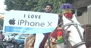 Man goes to purchase iPhone X riding a Horse with Dhol
