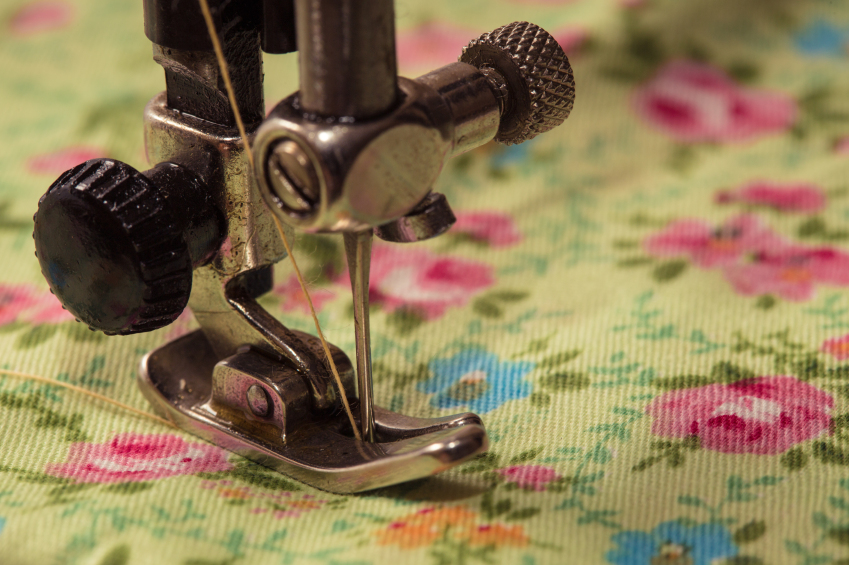 Sewing machine foot on floral cloth