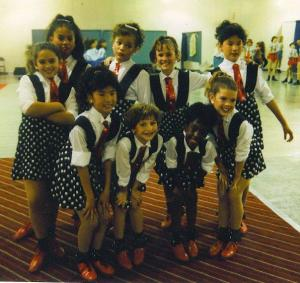 "Alice Faye Tap Dancer's. We danced to ""In The Mood."" I'm the little Asian girl on the front row."