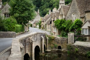 The quaint fairy tale village of Castle Combe at the border between the Cotswolds and Wiltshire with its characteristic bridge. Rural England at its best.