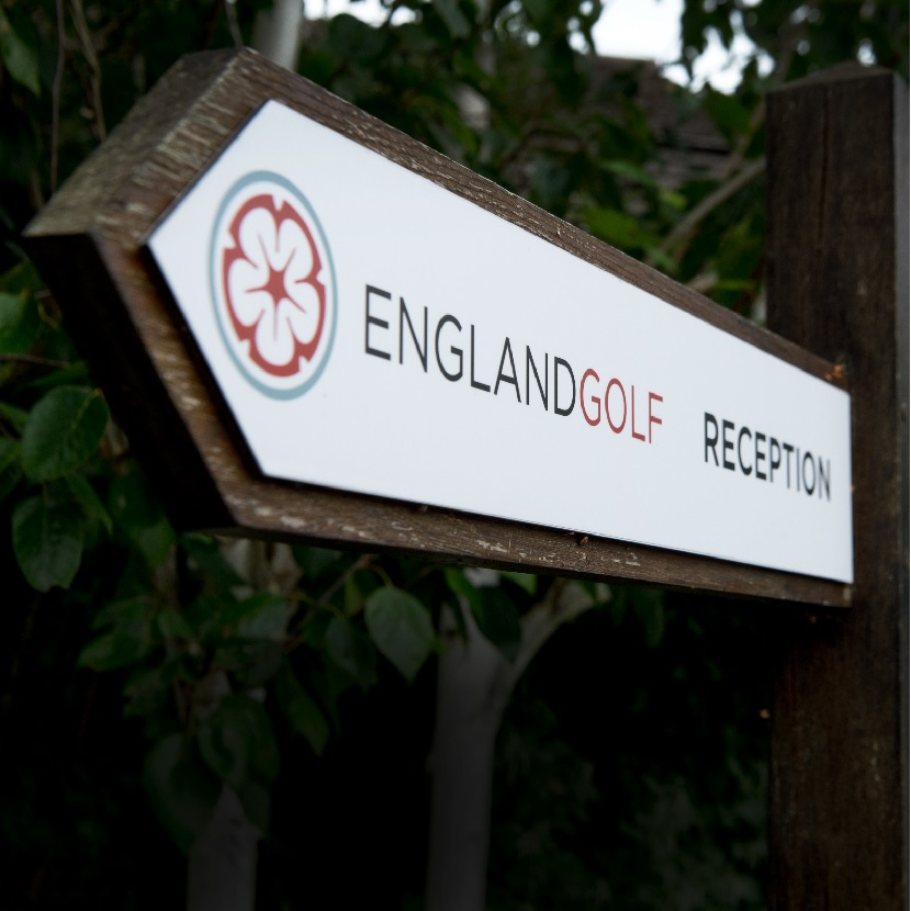 Directional signage pointing towards the England Golf reception
