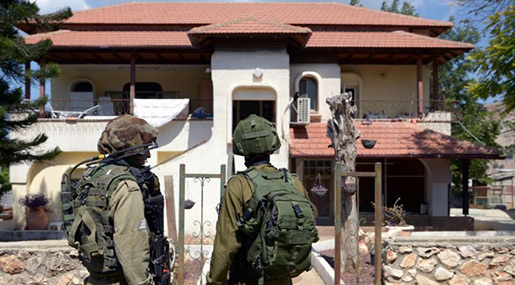 """Israeli"" soldiers infront of a settlement"